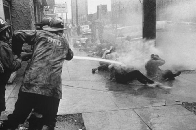 Children protesting in Birmingham 1963, sprayed with fire hoses