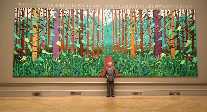 Hockney poses before Arrival of Spring in Woldgate