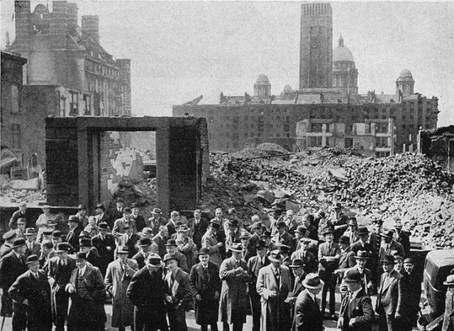Members of Liverpool Corn Exchange outside the bombed building during the Blitz.
