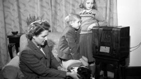 1950s family listening to the radio