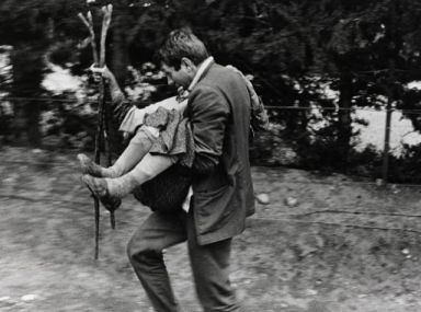 McCullin carrying a woman to safety, Cyprus 1964
