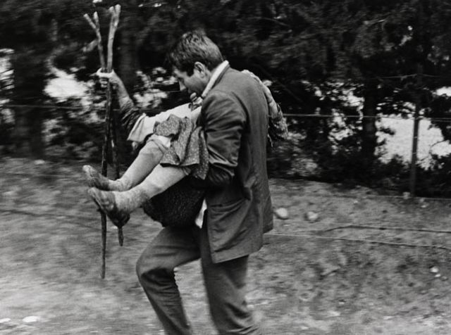 McCullin carrying woman, Cyprus 1964
