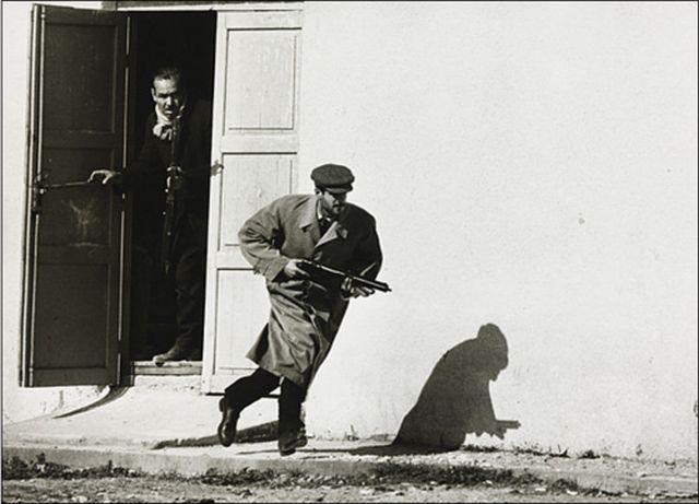 Turkish Cypriot sprinting from a cinema door under fire, Limassol, Cyprus, 1964