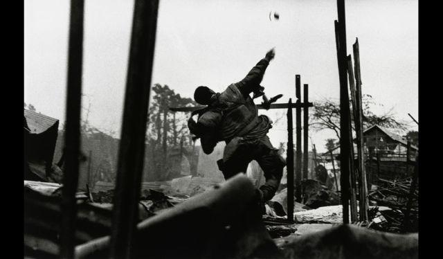 McCullin US Marine hurling a grenade in Hue