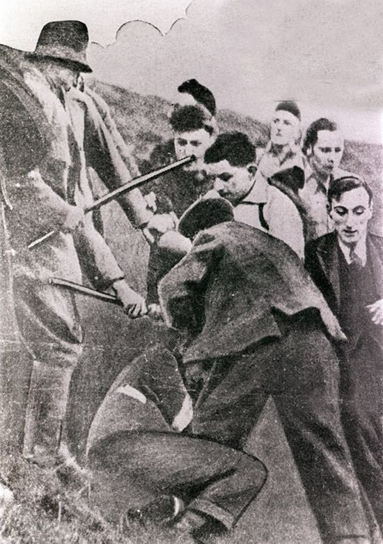 Fighting between gamekeepers and ramblers during the mass trespass of Kinder Scout in 1932