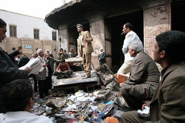 Iraqi poet Ahmed Abdel Sara recites a poem in ruins of Al-Mutanabbi Street