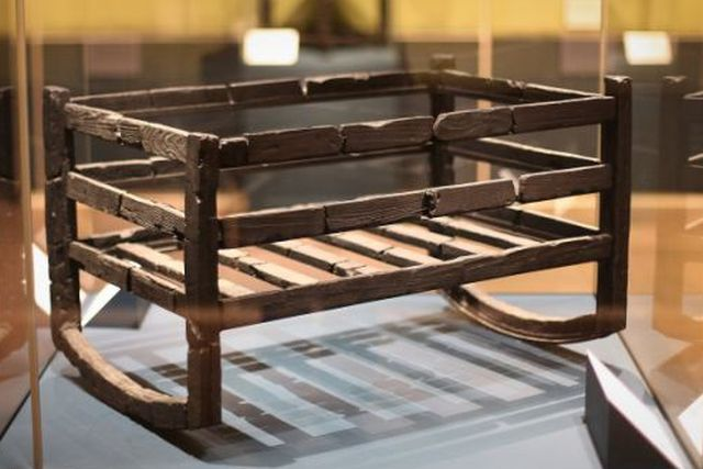 Pompeii exhibition charred cradle in which a baby's bones were discovered in Herculaneum