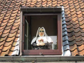 Nun at the window