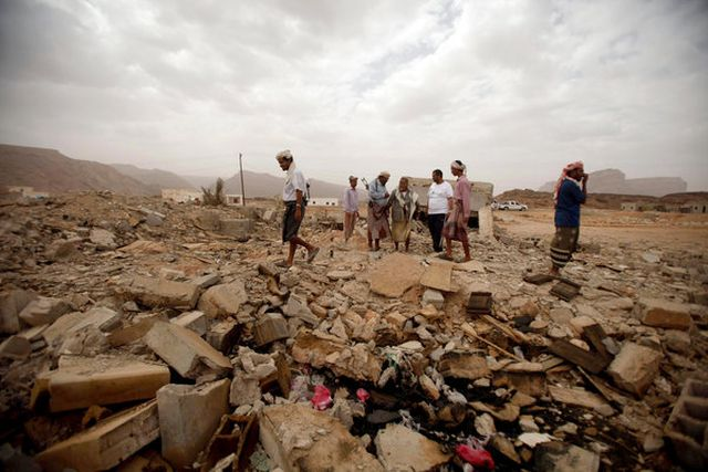 Tribesmen on Sunday on the rubble of a building destroyed on Oct. 14, 2011, in an American drone strike against suspected militants in Shabwa Province in southeastern Yemen.