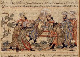 An agent (fida'i) of the Ismailis («Order of Assassins») (left, in white turban) fatally stabs Nizam al-Mulk, a Seljuk vizier, in 1092, Topkapi Palace Museum