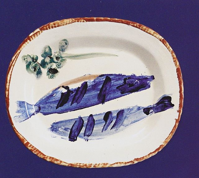 Composition with two fish and a sprig of parsley