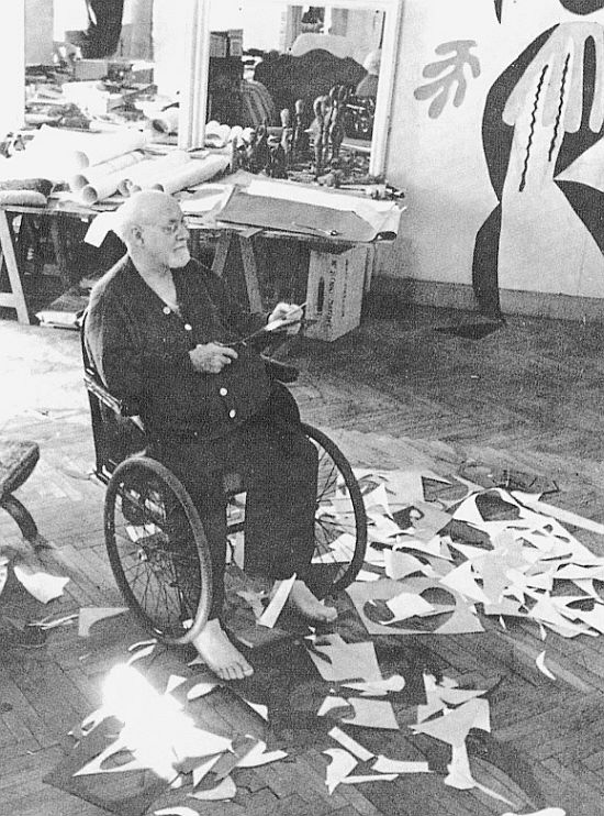 Matisse at work at his paper cut outs in his studio at Nice, 1952.