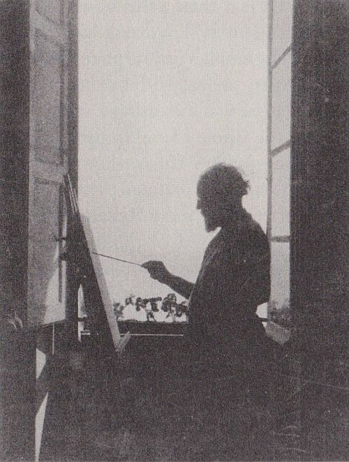Matisse painting at his third floor studio window, Place Charles Felix