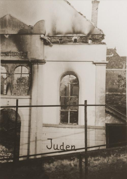 Jews scrawled on the exterior wall of the destroyed synagogue in Buehl