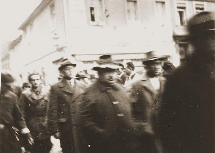 Members of the SA march Jewish men through the streets after their arrest during Kristallnacht. Erlangen, Germany. November 10, 1938