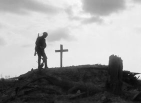 A British soldier stands besides the grave of a comrade near Pilckem during the Third Battle of Ypres, 22 August 1917 Ernest Brooks