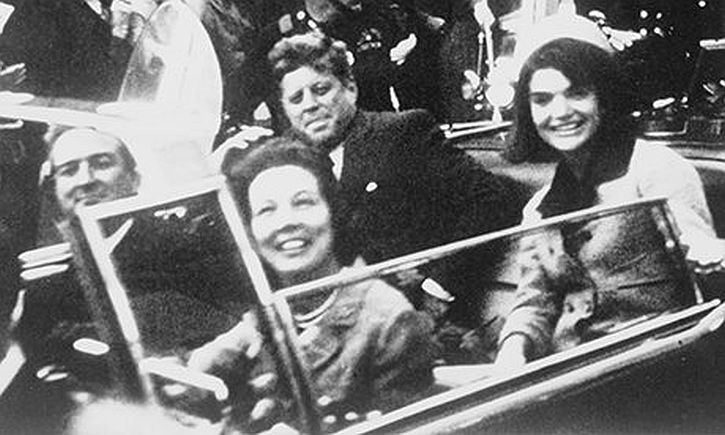File handout image shows President Kennedy and  Jacqueline Kennedy riding in motorcade in Dallas