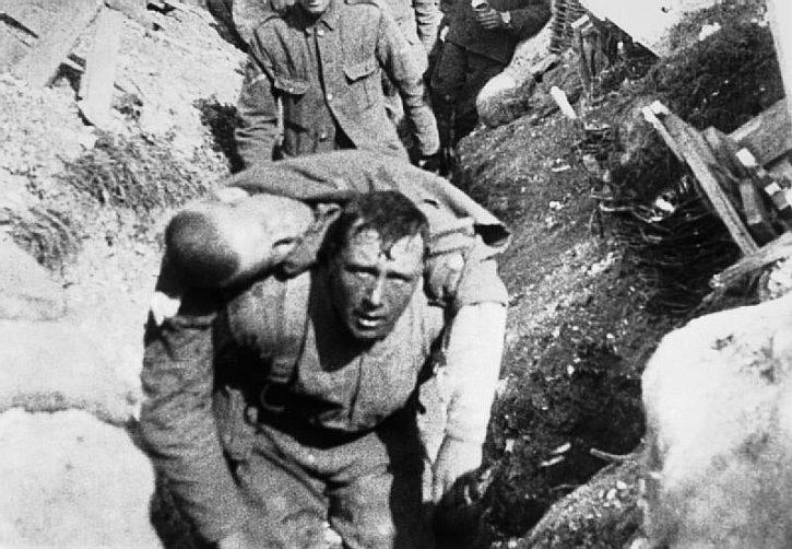 Frame from sequence 34 British Tommies rescuing a comrade under shell fire