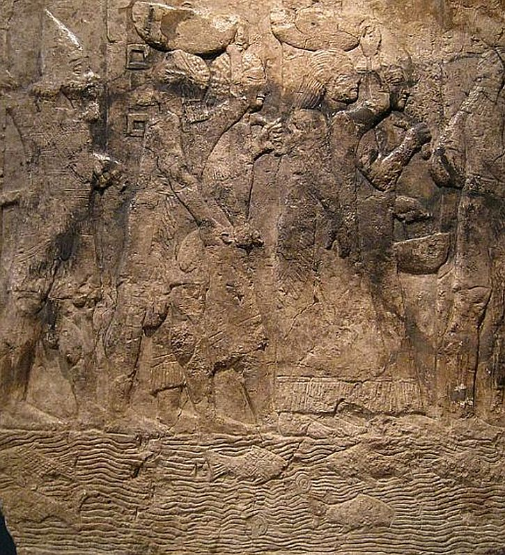 Assyrian relief from Nineveh, depicting a soldier escorting captives and loot from a Babylonian city in central or southern Iraq. Early 7th century BC.
