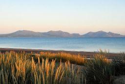 A midsummer eve walk to the beach beneath the mountains