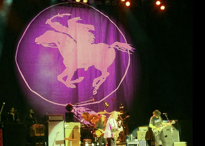 Neil Young and Crazy Horse performing at  Arena