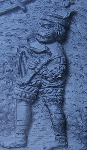 A wooden carving of a Welsh harpist from around 1510