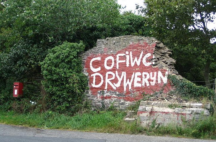 Cofiwch Dryweryn' 'Remember Tryweryn' Welsh nationalist graffiti on roadside wall near Llanrhystud Ceredigion