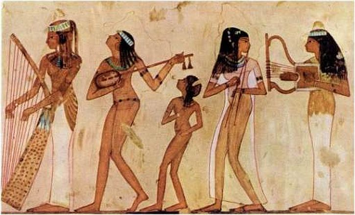 An Egyptian tomb painting of musicians with harps