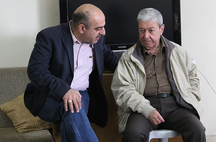 Iyad Rafidi, left, principal of the Arab Evangelical Episcopal School in Ramallah, West Bank, talks with Bashir Khairi, 2011