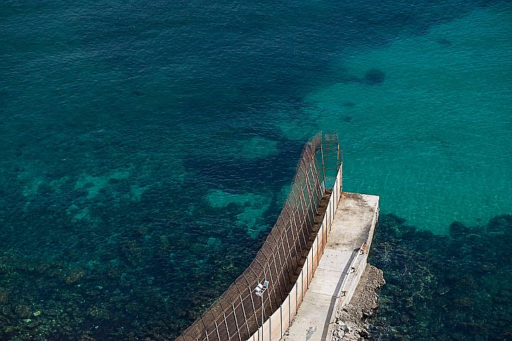 Melilla fence sea