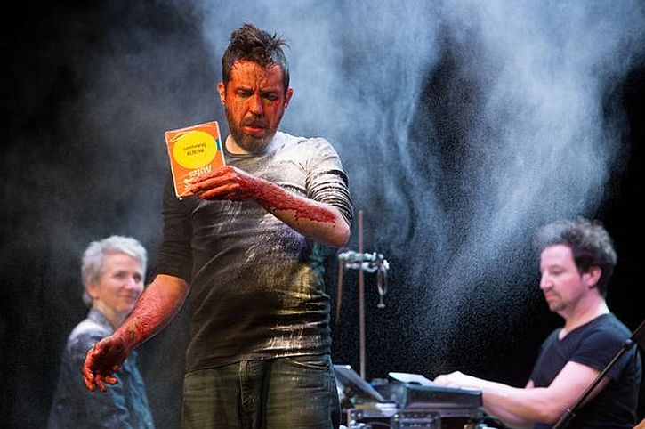 Ferdy Roberts as Macbeth (with Brodie's Notes) in Filter Theatre's Macbeth