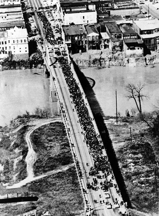 Thousands strong, the march crosses over the Edmund Pettus Bridge