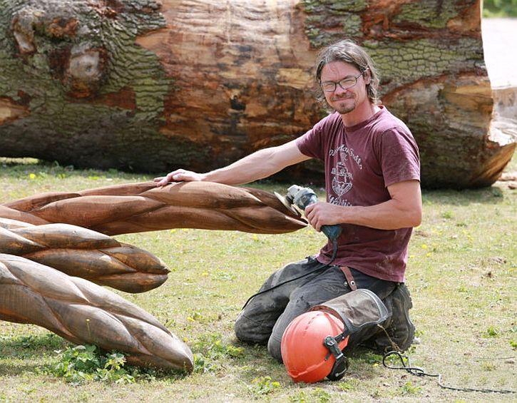 Sculptor Simon Archer creating the Asparagus Trail spears at Formby
