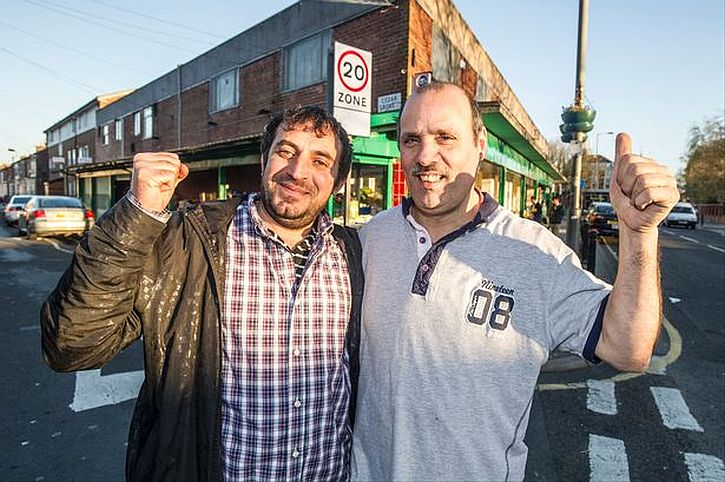 Staff members Sadar Rashid, left, and Jaber Mohamed, right, celebrate after the L8 Superstore in Lodge Lane was nominated for a top retailer award by Radio 4