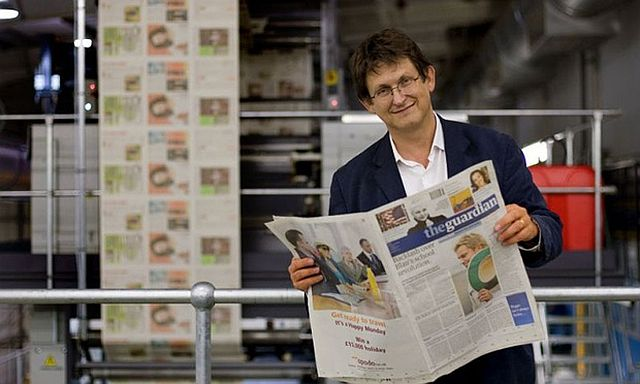 Alan Rusbridger with the first copy of the new Guardian Berliner newspaper in September 2005