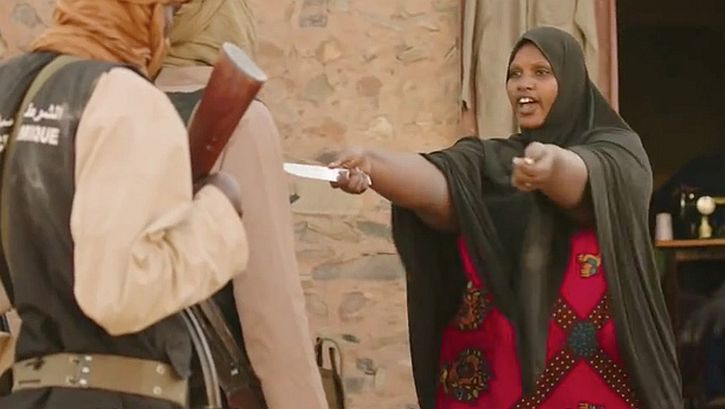 Threatened by Islamists a woman challenges them to cut off her hands
