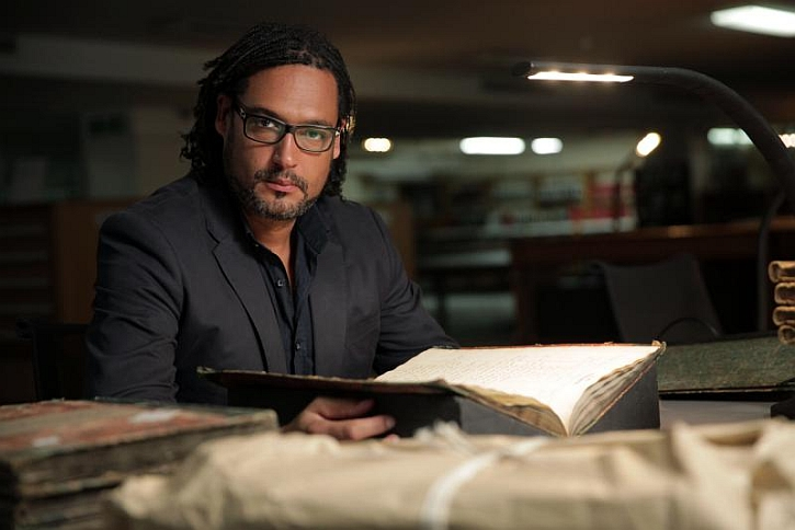 David Olusoga in the National Archive at Kew examining British slave registers
