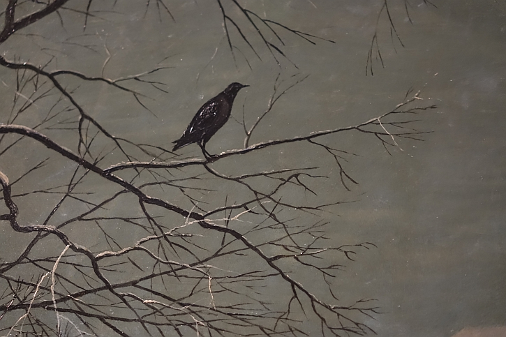 Hunters in the Snow, detail: a bird in a tree