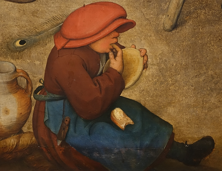 The Peasant Wedding, detail: the child in the red cap