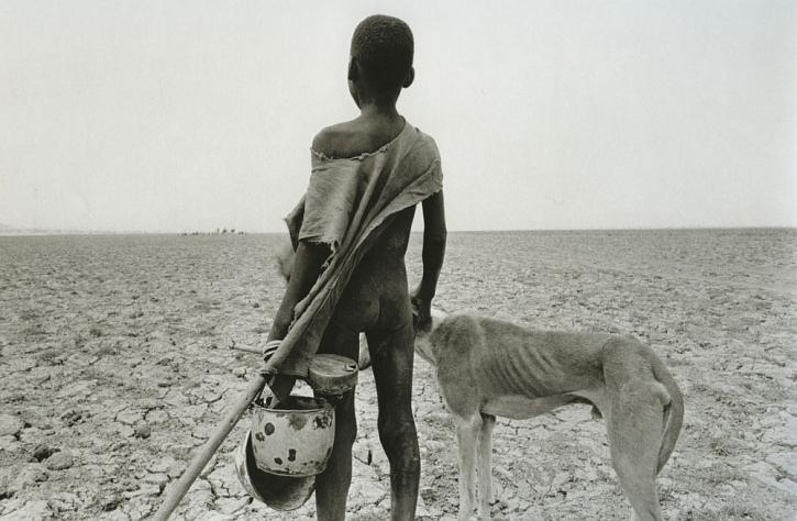 Salgado, Sahel, 1984 boy and dog