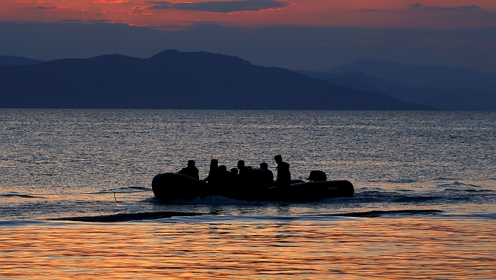 A dinghy with Syrian refugees is towed by a Greek coast guard patrol boat into port on Greek island of Kos, following a rescue operation, May 31, 2015