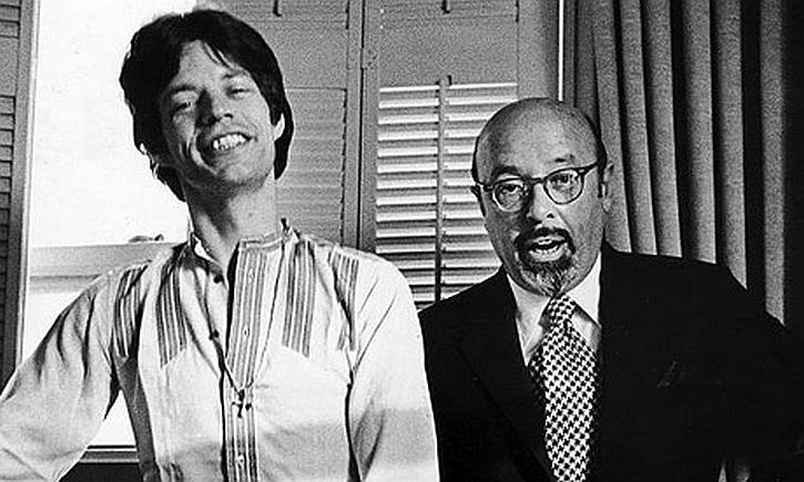 Ahmet Ertegun and Mick Jagger in his office in 1973