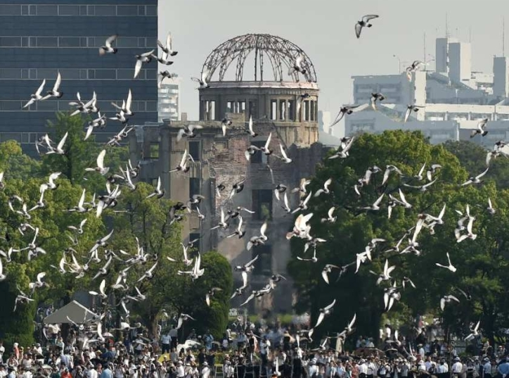 Doves fly over the Hiroshima Peace Memorial Park on 6 August 2015 during a memorial ceremony to mark the 70th anniversary of the atomic bomb being dropped