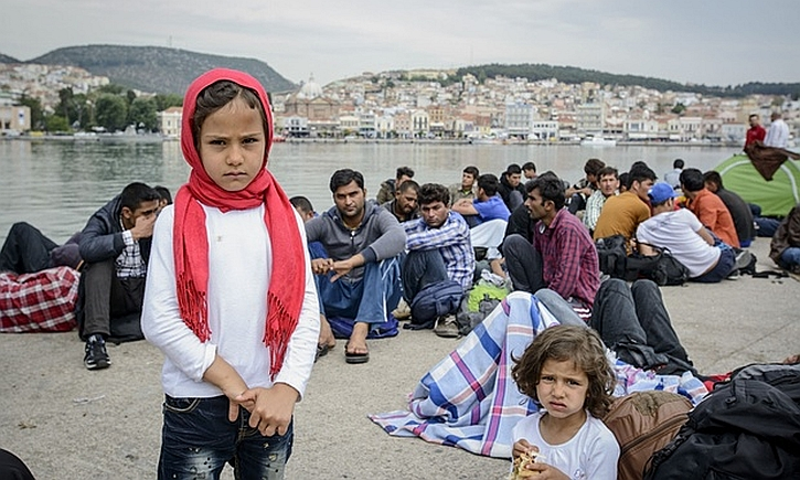 Newly arrived refugees wait to be registered in Mytilini harbour, Lesbos