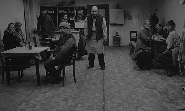 Satantango: waiting in the bar (scene from Bela Tarr's film)