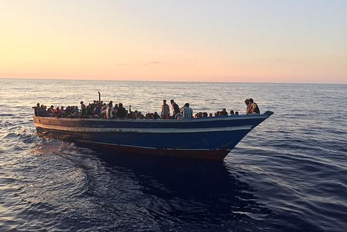 Patrick Kingsley's image of a refugee boat rescued in the Mediterranean