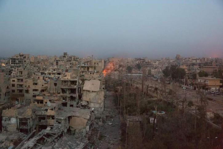 The ISIS-controlled area of Deir-ez Zor, greatly damaged by artillery and aerial bombing, photographed by Time magazine