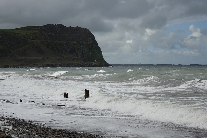 Waves crash against the remains of the old jetty