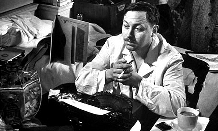 Tennessee Williams at his desk in 1948