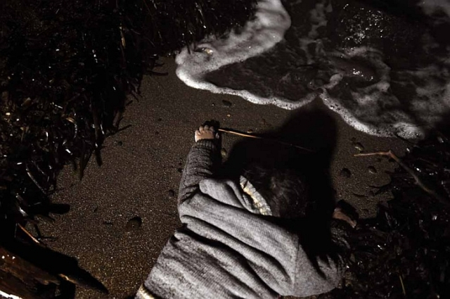 A drowned child lies on a Lesbos beach. AFP Aris Messinis